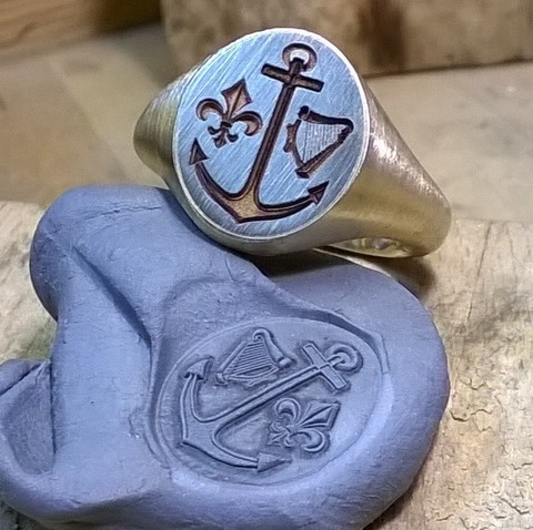 Impression from 2d crest engraved harp anchor ring