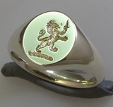 Rampant lion with dagger crest engraved signet ring