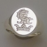 Lion head above coronet crest engraved signet ring