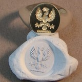 Phoenix eagle crest impression in blue tack